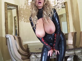 Kelly Madison is a honey in a latex outfit who loves masturbating