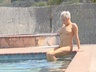 Ryan exposes her huge gut and takes a naked douse close to the pool