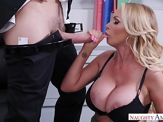 Shove around blonde MILF Nikki Benz takes cumshot in the office