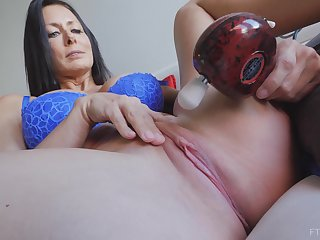 Shadowy MILF Reagan plays gifts a vibrator on her clit until she cums