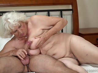 Torrid granny gets her pussy serviced by a young guy